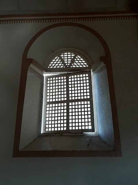 wooden-framed capis windows