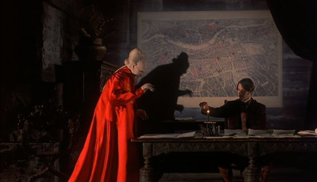Dracula's shadow is cast across a map of London