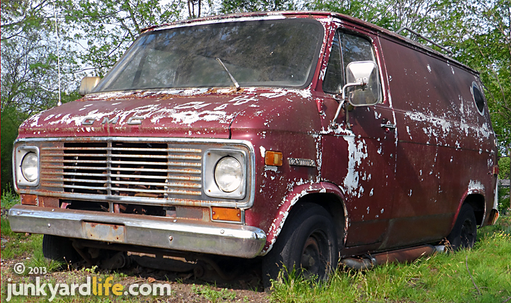 Peeling paint, flat tires do not help the resale value of a vintage 1970s van.