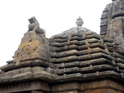 A lion perched above the pyramidal jagamohana at the Rajarani Temple, Bhubaneshwar