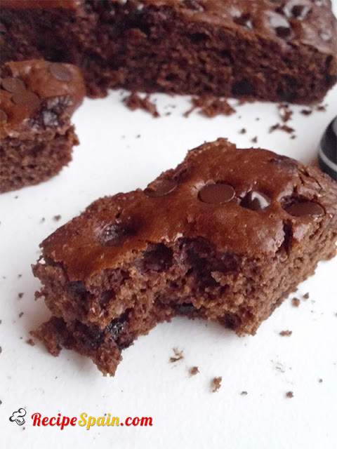 Chocolate sponge cake with chocolate chips bitten