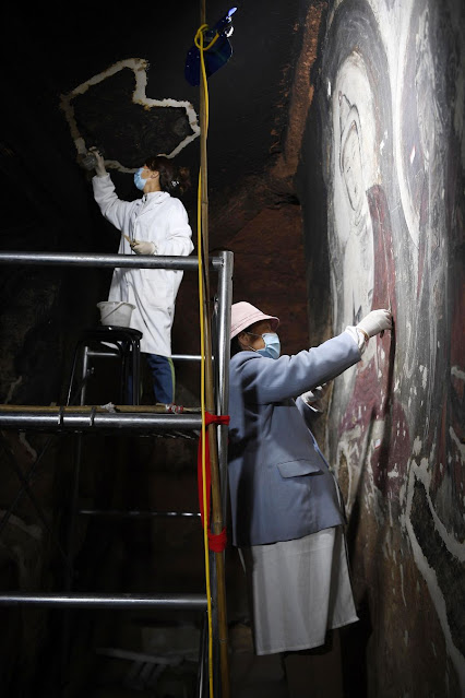 Restoration of Xumishan Grottoes underway in NW China