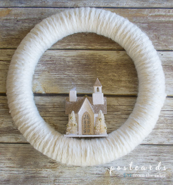 white chunky knit sweater wreath with little glitter house