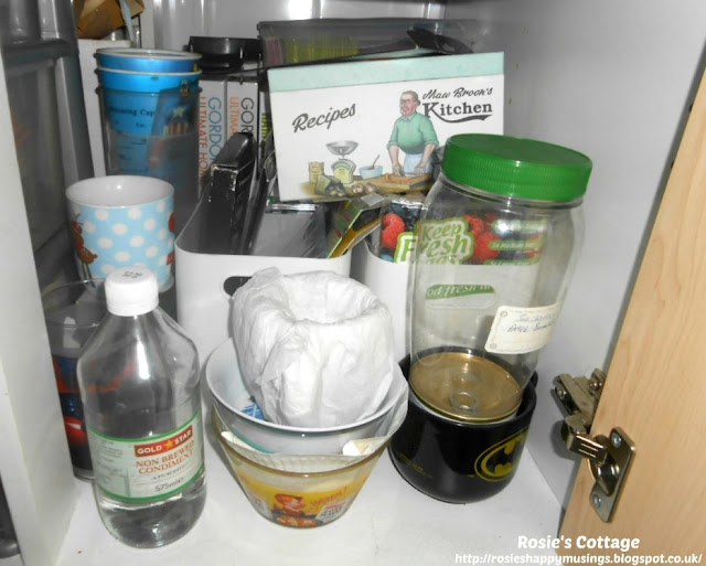Kitchen Cabinet Re-Organisation: What a mess! Time to get to work.. first I had to empty everything out.