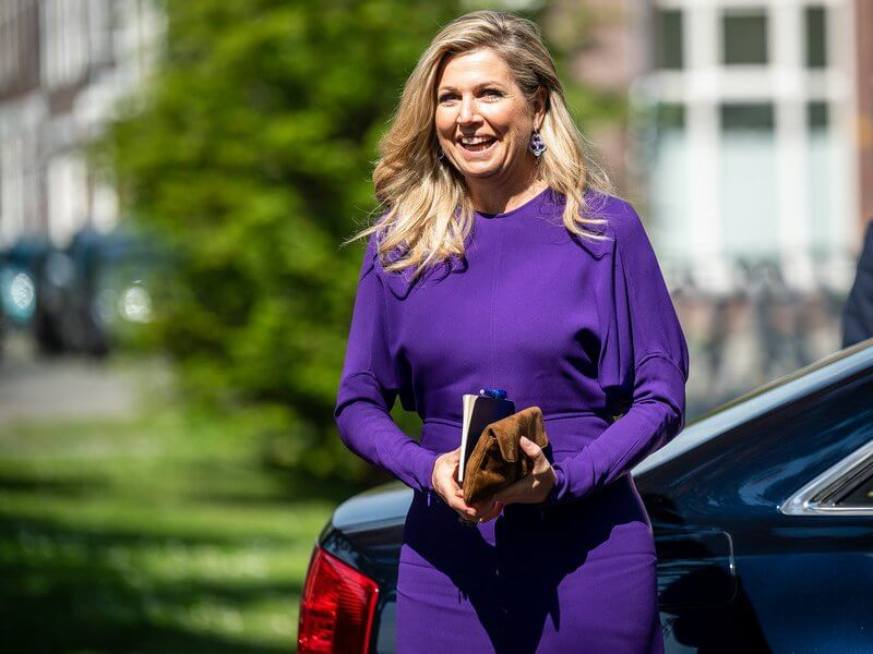 Queen Maxima wore a puffled sleeves dolman midi dress from Victoria Beckham, and yellow floral print silk satin dress from Natan