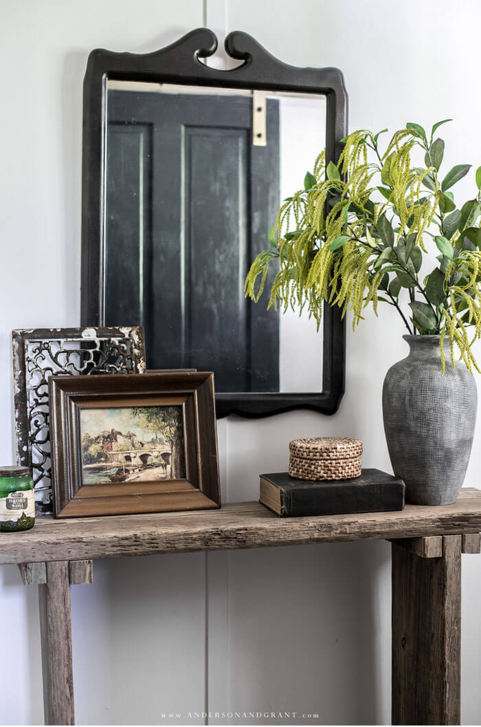 Mirror hanging over console table