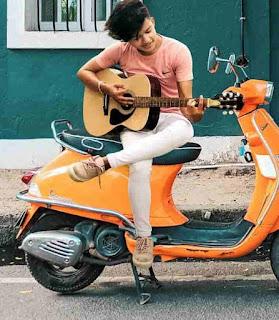 Riyaz Aly Playing Guitar