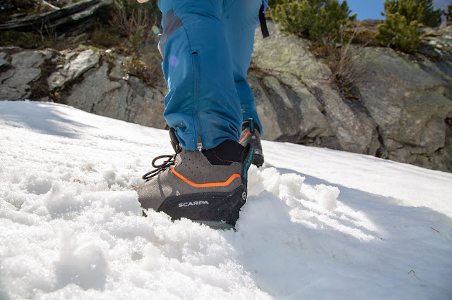 Close up shot of the SCARPA Zodiac Plus GTX boot stepping into deep snow.