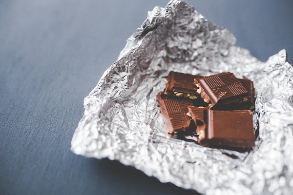 Squares of chocolate sitting on tin foil