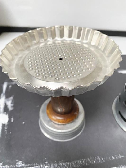 pie tin piece with spool and mason jar lid