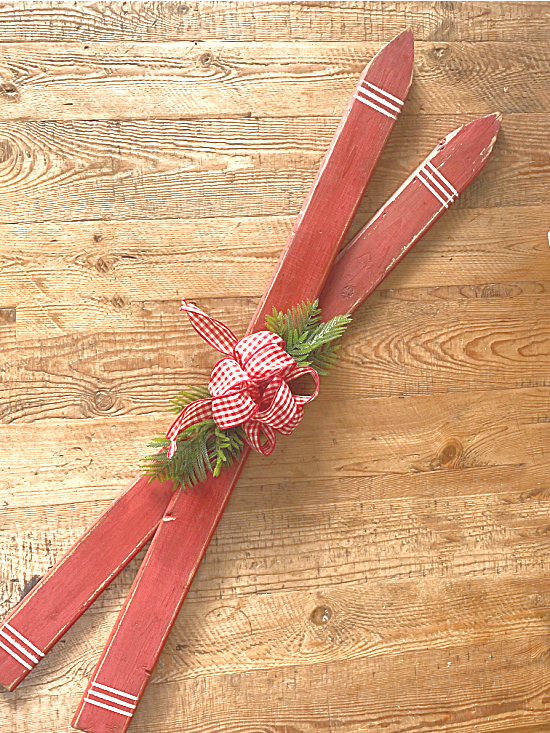 Red skis with a bow and greenery