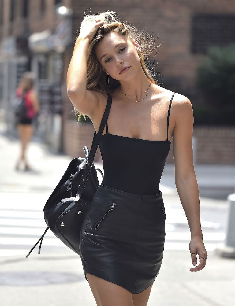 Alexis Ren sexy in black mini skirt out in New York City