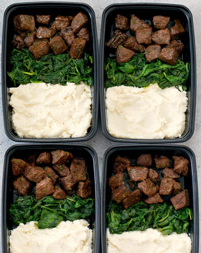 Garlic steak bites are served with creamy mashed cauliflower for a low carb version of steak and potatoes. This easy meal is tasty and perfect for your weekly meal prep.