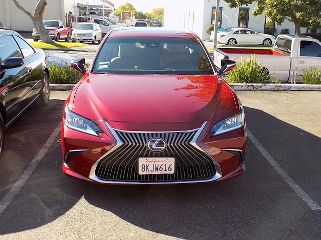 Lexus with new hood, bumper, grill, headlights and paint from Almost Everything Auto Body.