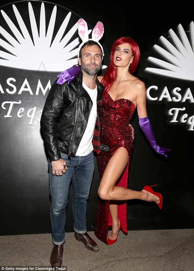 Alessandra Ambrosio dresses up as Jessica Rabbit as she hits the Casamigos Halloween party