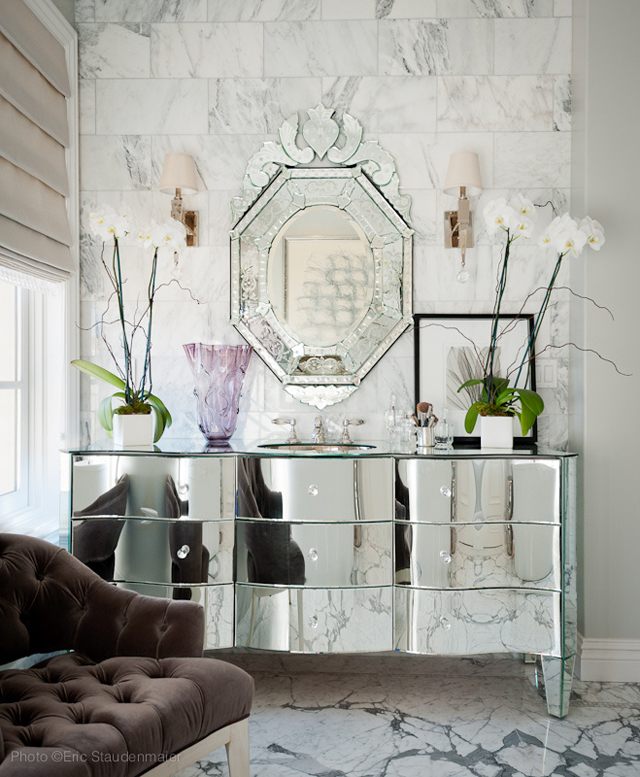 Marble bathroom with ornate mirror