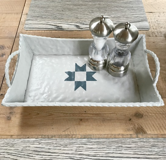 metal tray with stenciled blue quilt design