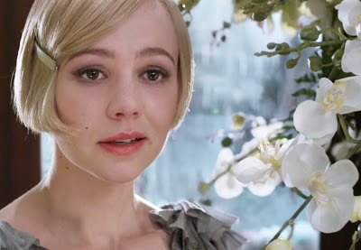 In The Great Gatsby, why might Daisy choose to remain with Tom instead of leaving him for Gatsby ?