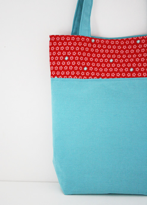 Aqua and red tote bag
