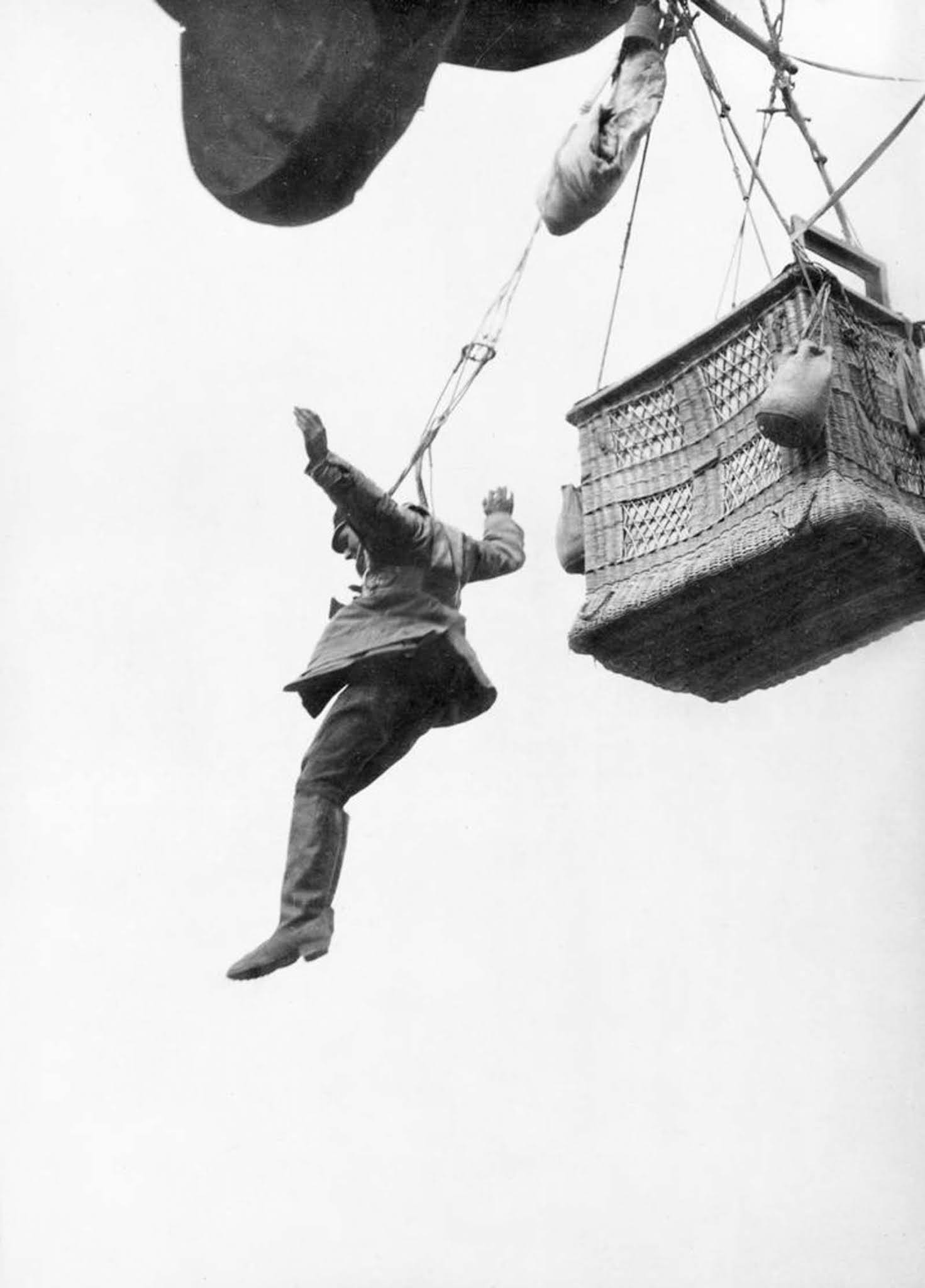 A German observer leaps from his balloon with a parachute. 1916.