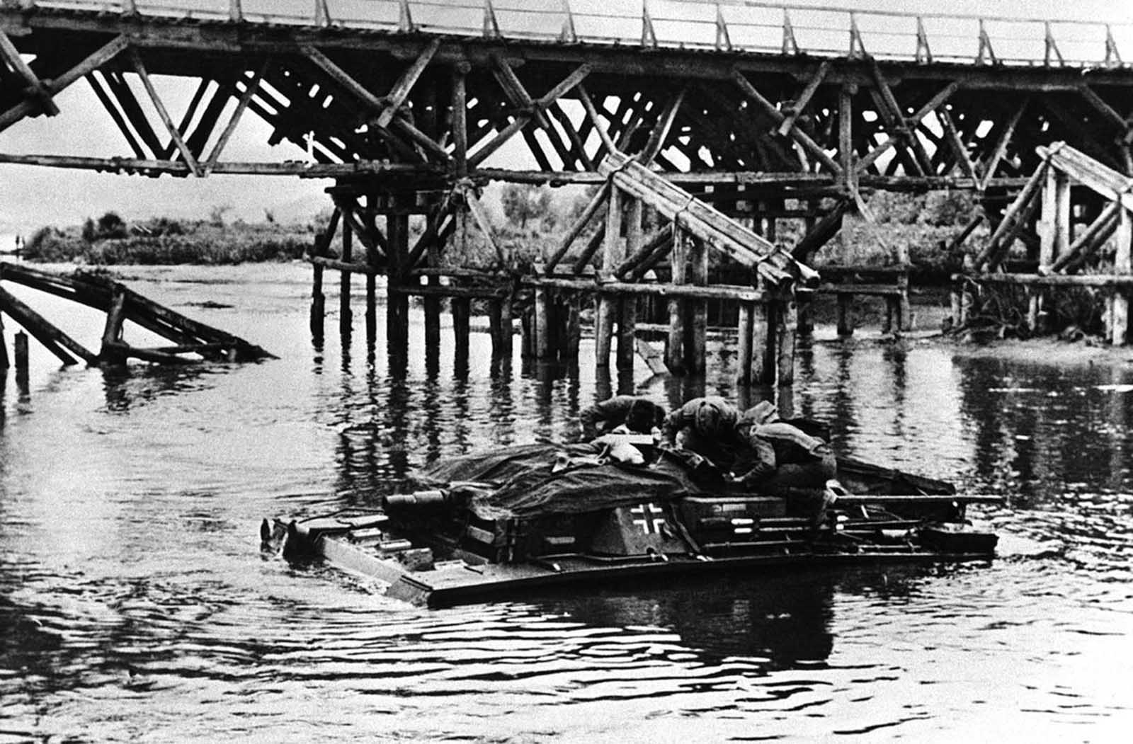 German soldiers crossing a Russian River on their tank on August 3, 1942.