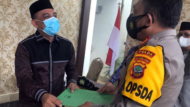 GP Ansor Serahkan Bukti Penghinaan Mantan Polisi terhadap Yaqut-Aqil ke Kapolda Sulut