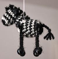 http://www.ravelry.com/patterns/library/miniature-zebra-africa-series