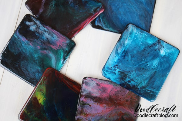 Make stunning galaxy coasters with high gloss resin and vivid colors. These amazing coasters are addicting to make with this fun resin pour technique.