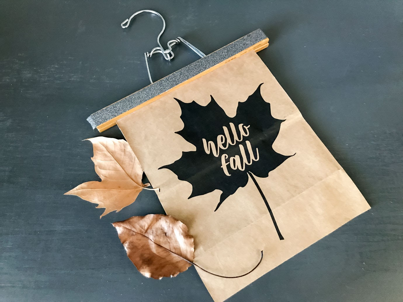 Hello Fall Leaf Printable and DIY flatlay on a dark background with real leaves