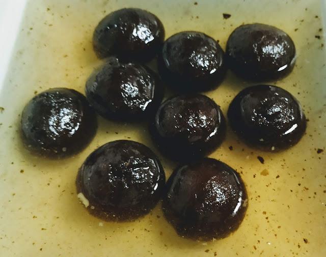 Jamun soaking in sugar syrup for Kala Jamun recipe
