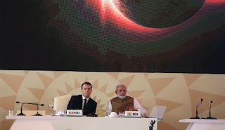 Macron announced the investment at the launch of the International Solar Alliance in New Delhi. (Photo Credit: Ludovic Marin/AFP) Click to Enlarge.