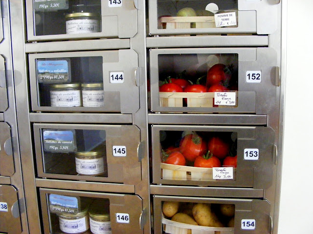Terrines and tomatoes in a vending machine.  Indre et Loire, France. Photographed by Susan Walter. Tour the Loire Valley with a classic car and a private guide.