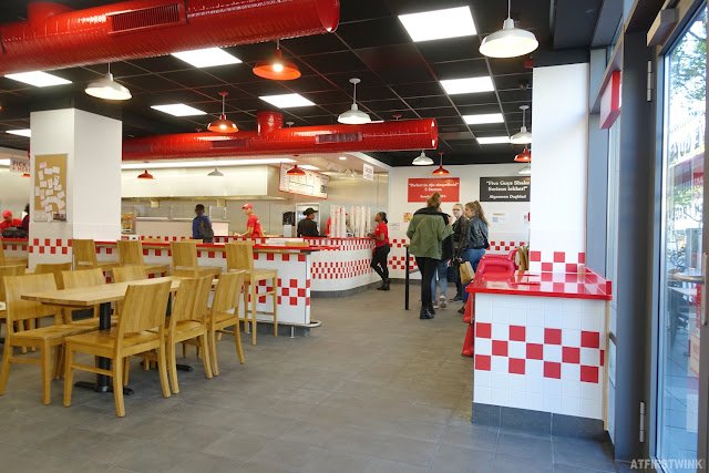 Five Guys restaurant Rotterdam city centre interior red white checkered pattern