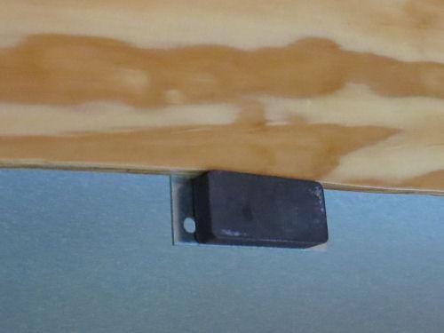 latch for an upper storage bin in a fiberglass trailer