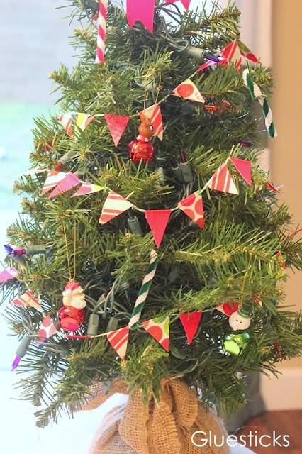 mini Christmas tree with duct tape bunting wrapped around