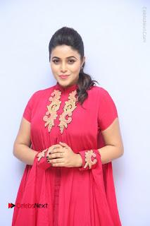 Actress Poorna Latest Stills in Red Dress at Rakshasi First Look Launch  0039.JPG
