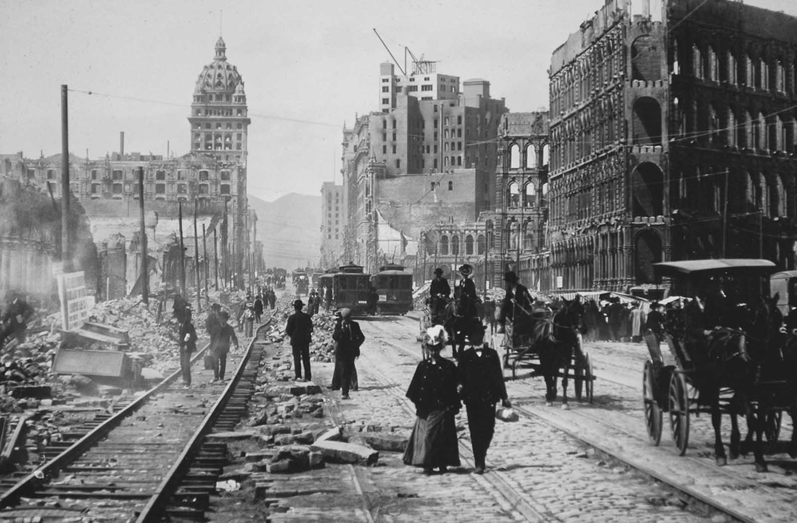 Market Street, looking west toward the Twin Peaks, from Battery Street. Both sides of Market Street lined with ruined buildings from Battery to Powell.
