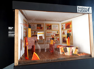 Closeup of an exhibition in a miniature gallery.