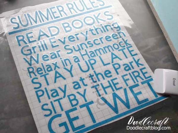 Place transfer tape on the vinyl cut with Cricut Maker to make a Summer Rules Cricut Vinyl Wood Sign DIY