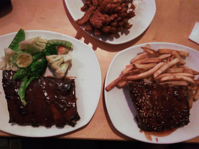 The main dish: ribs with steamed vegetables and French fries as sides.