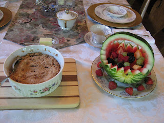David's apple crisp (on left) and Susan's carved watermelon basket filled with fresh, cut fruit