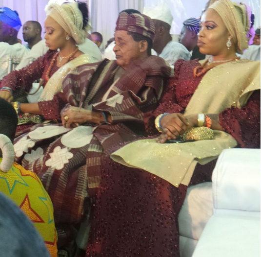 Image result for wife of Alaafin of Oyo caught on camera looking at Lizzy Anjorin with disgust