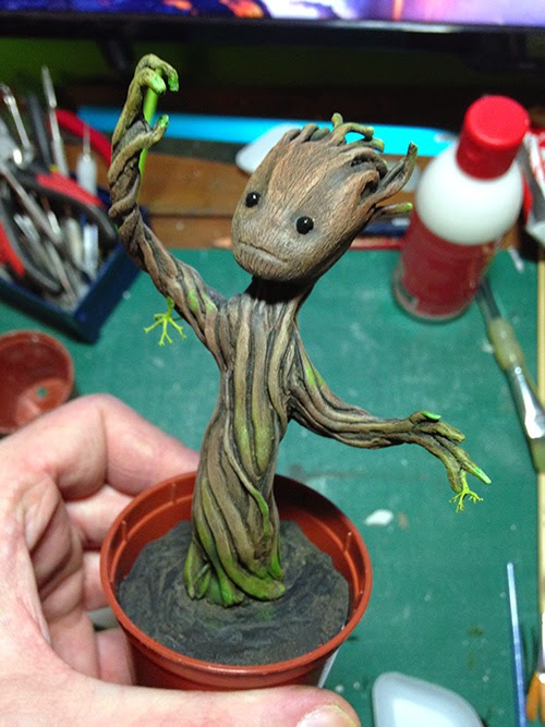 Gluing moss to the painted Groot