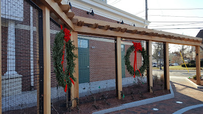 wreaths on the backdrop in the new Horace Mann Square