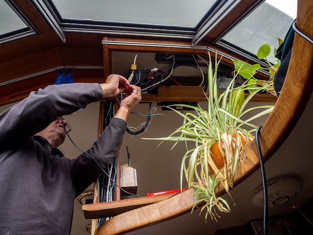 Photo of Phil fitting our new VHF radio