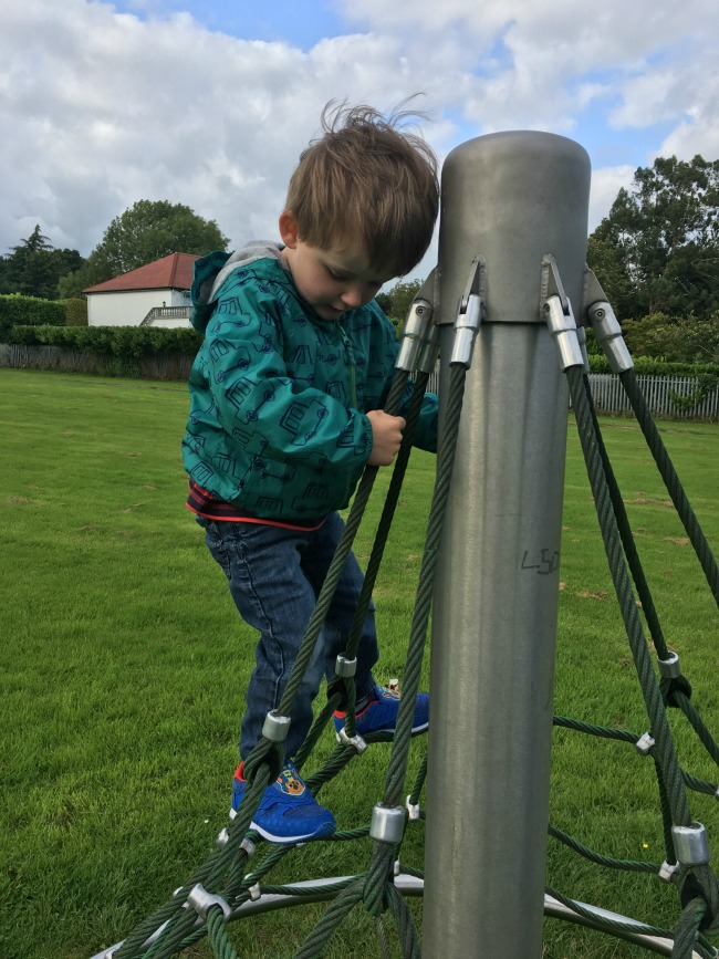 boy-on-climbing-frame