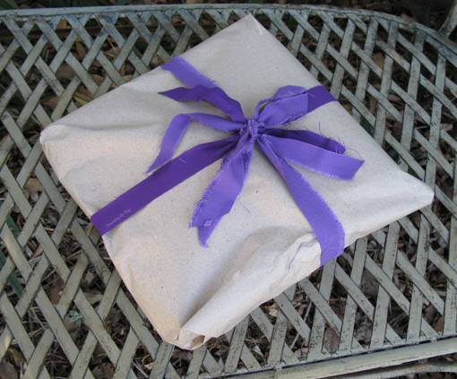 What do you do with selvedges and long, thin offcuts of fabric? Use them instead of ribbons for gift wrapping ~ Threading My Way