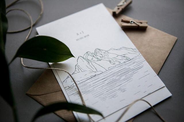 Minimalistyczne zaproszenia ślubne od isu studio z motywem górskim.