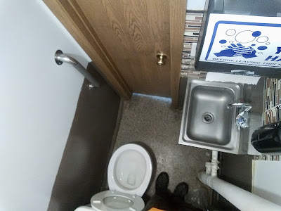 An over head view of a small bathroom.