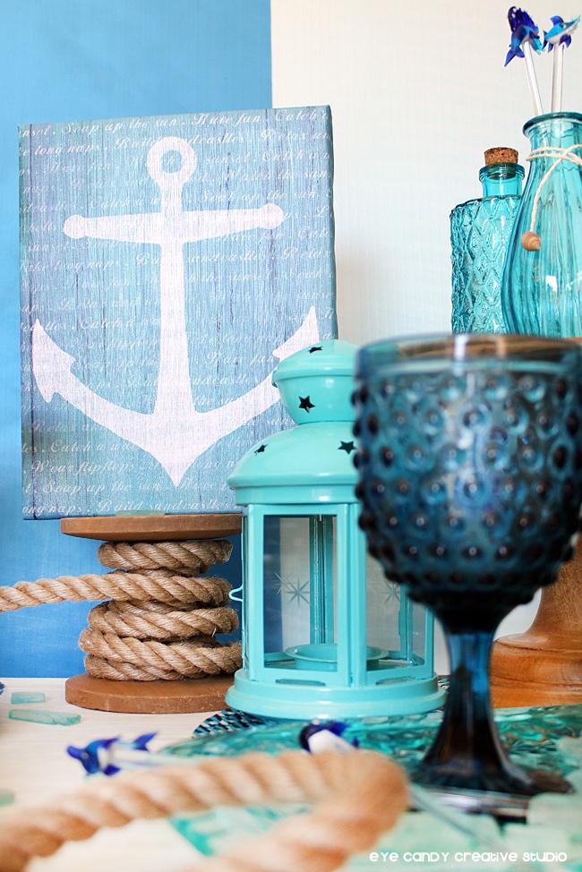 anchor art, spol of rope, sea glass, lantern, aqua vases, glassware